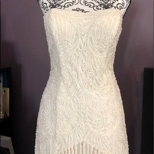 Beaded with fringe ivory Sue Wong gown.